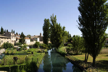 bevagna: ancient village of bevagna from the river