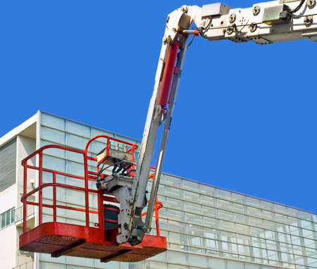 building maintenance: moves toward the basket elevator glass building