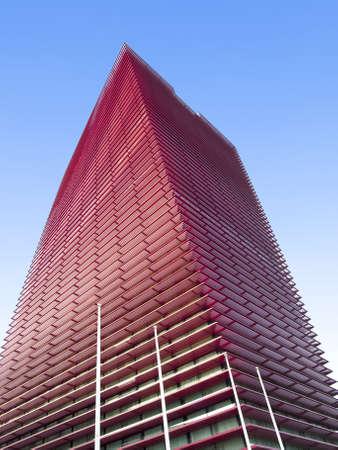 caresses: Red skyscraper caresses the sky