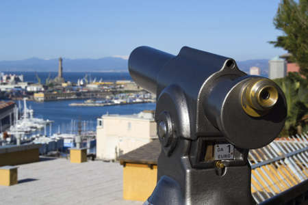 operated: Coin operated telescope on a hill with a Modern City as a backdrop