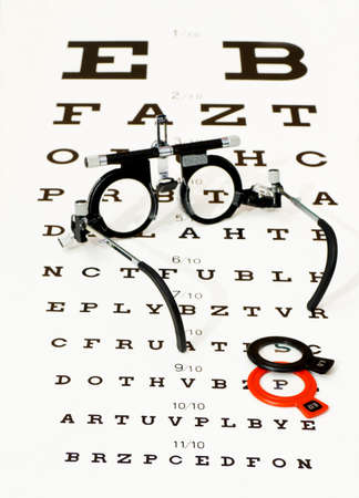 testing vision: glasses lying on optotype test