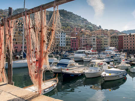 bobber: View to the port of Camogli, Italy through a fishnet Stock Photo