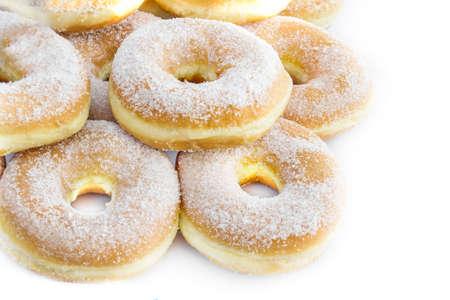 sugarcoated: sugar-coated donuts on white background