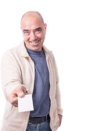 Man holds out business card