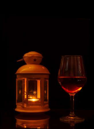 Glass of wine illuminated by a lantern