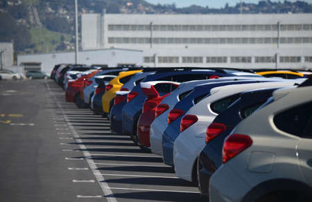 Brand New Cars Lined Up in a Parking Lot
