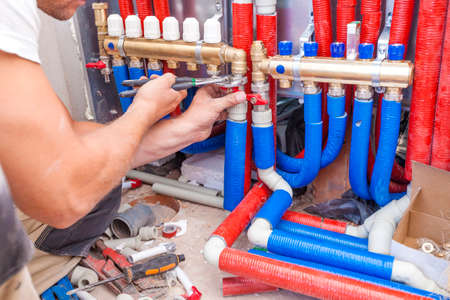 Plumber mounted distributor of central heating Banco de Imagens