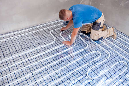 Pipe. fitter mounted underfloor heating. Heating system and underfloor heating. Stock fotó