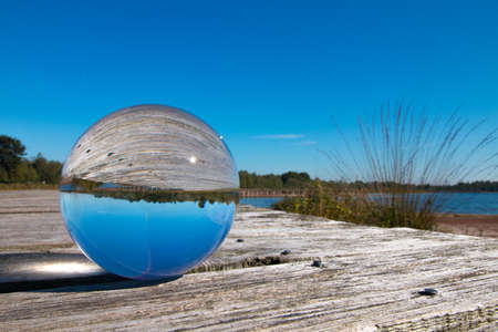 maldives island: Landscape with blue sky in glass sphere