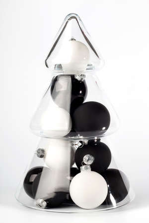 it is isolated: glass christmas tree with black and white balls in it, isolated on white background