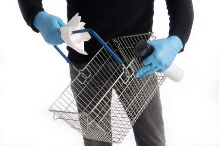 Shopping basket being cleaned by hands with gloves, isolated on white background Stock fotó