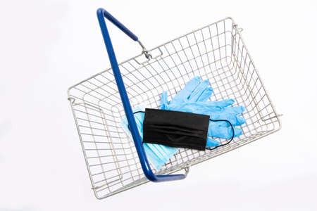 Shopping basket with mouth protection and hand gloves, top view, isolated on white background