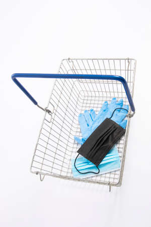 Shopping basket with mouth protection and hand gloves, isolated on white background Stock fotó
