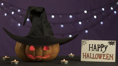 Jack-o-lantern head with burning candles