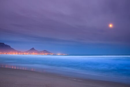 View of Table Mountain at sunrise, Cape Town, South Africa from Milnerton Beach Stock Photo