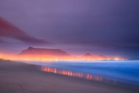 View of Table Mountain at sunrise, Cape Town, South Africa from Milnerton Beach