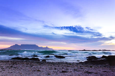 View of Table Mountain at sunrise, Cape Town, South Africa from Milnerton Beach coastline Stock Photo