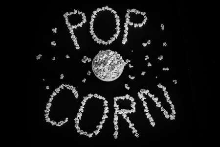 Popped Popcorn (maize kernels) and shaped in the word 'popcorn'
