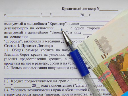 Business contract with a pen and 10000 rubles photo