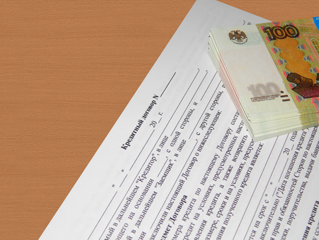 Credit agreement for an office desk with a bundle of money photo