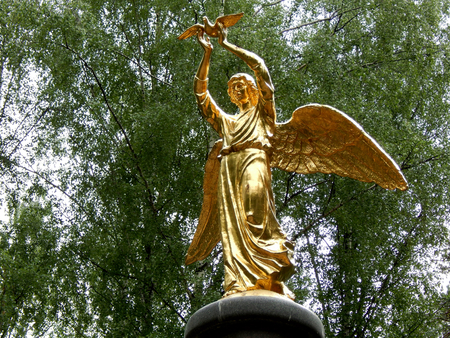 goodness: Golden statue of an angel of goodness and peace