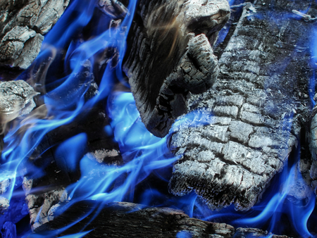 blue flame: Bonfire with white coals with blue flame