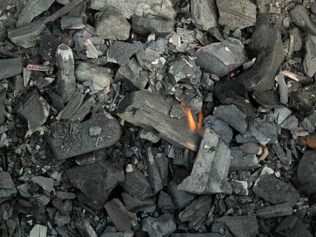 coals: Black coals from the fire burned down