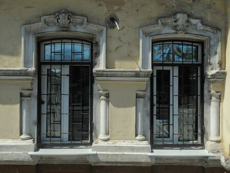 moldings: Old windows with antique moldings from plaster