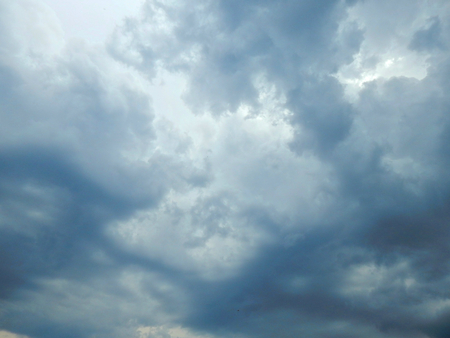 slight: Storm clouds in the sky with a slight clearance