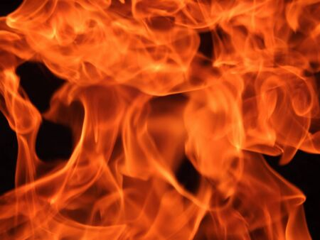 Red flame fire on a black background closeup Stock Photo