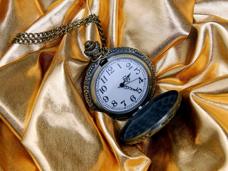 Antique clock on a gold background Stock Photo