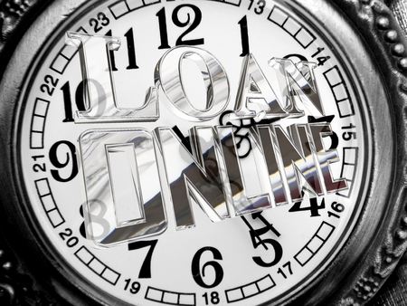 Silver text loan online against the background of an antique clock dial Stock Photo