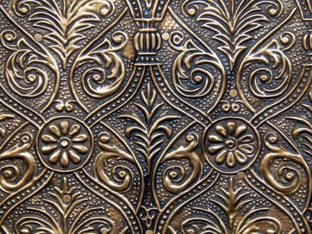 old metal: The decorative pattern on the old shabby gold