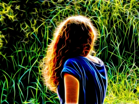 Image of a girl with curly hair in neon light Stock Photo