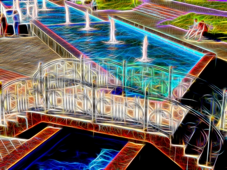 Picture of a square of fountains in neon light Stock Photo