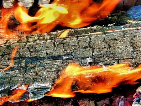 hellish: Burning bonfire with red corners close-up