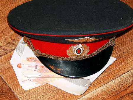 A police cap with money