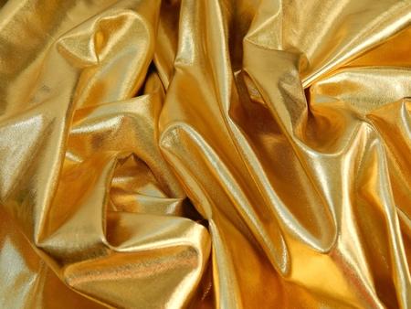 Gold satin material close-up