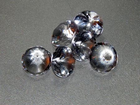 silvery: Diamonds on a silvery background closeup Stock Photo