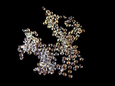Brilliant diamonds on a black background closeup