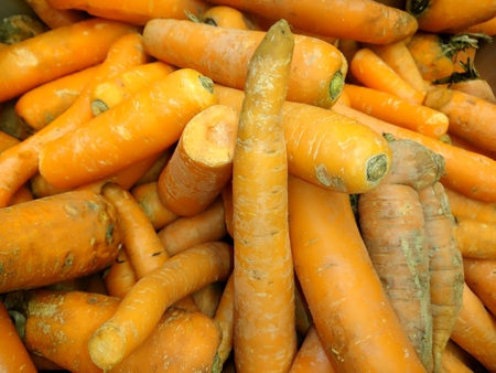 Fresh carrots in a close-up box
