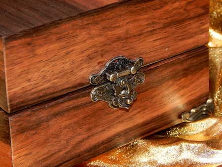 Casket for jewelry in Art Nouveau style on a gold background