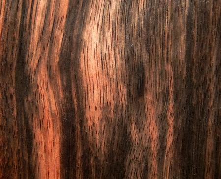 Wood surface of ebony Eben Makassar. Decorative material for furniture
