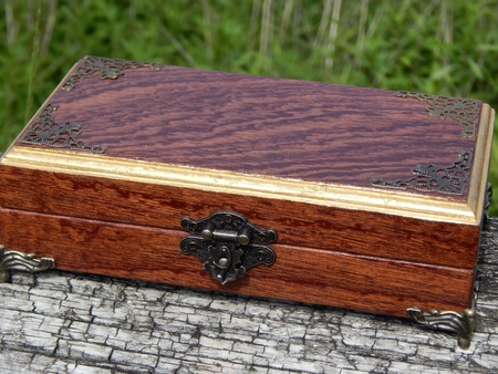 Casket of Mahogany Mahogany handmade on a green background