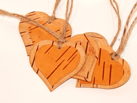 Heart made of birch bark on a background. Manual work in design