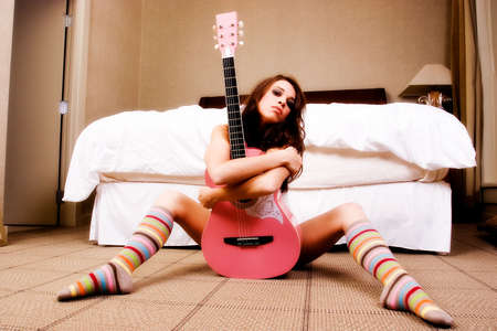 hot pink: Pink Guitar in between the legs of a hot brunette