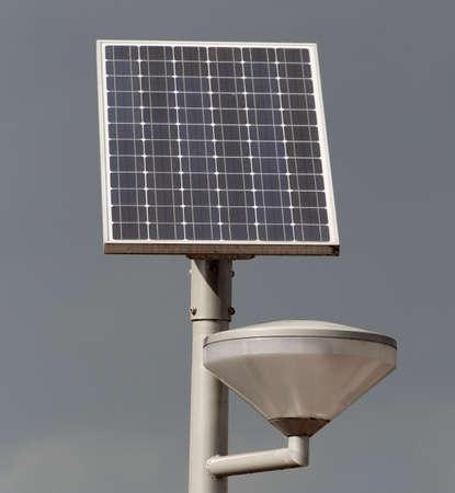 solarpower: Solar powered street light against a stormy sky
