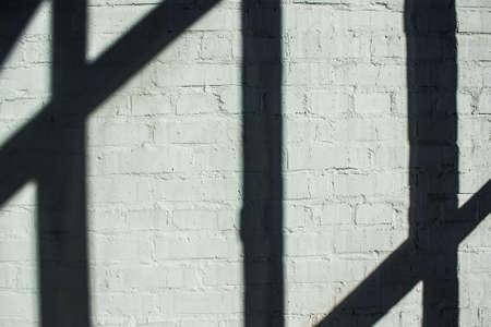 lath: Strips shadow of wood lath on bricks wall. Stock Photo