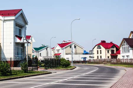 vicinity: Street road view with new village development and sky illustration.