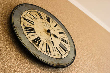 Vintage watch on grunge white wall. photo